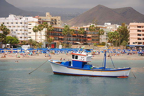 Boat in front of Tenerife beach hotels photo